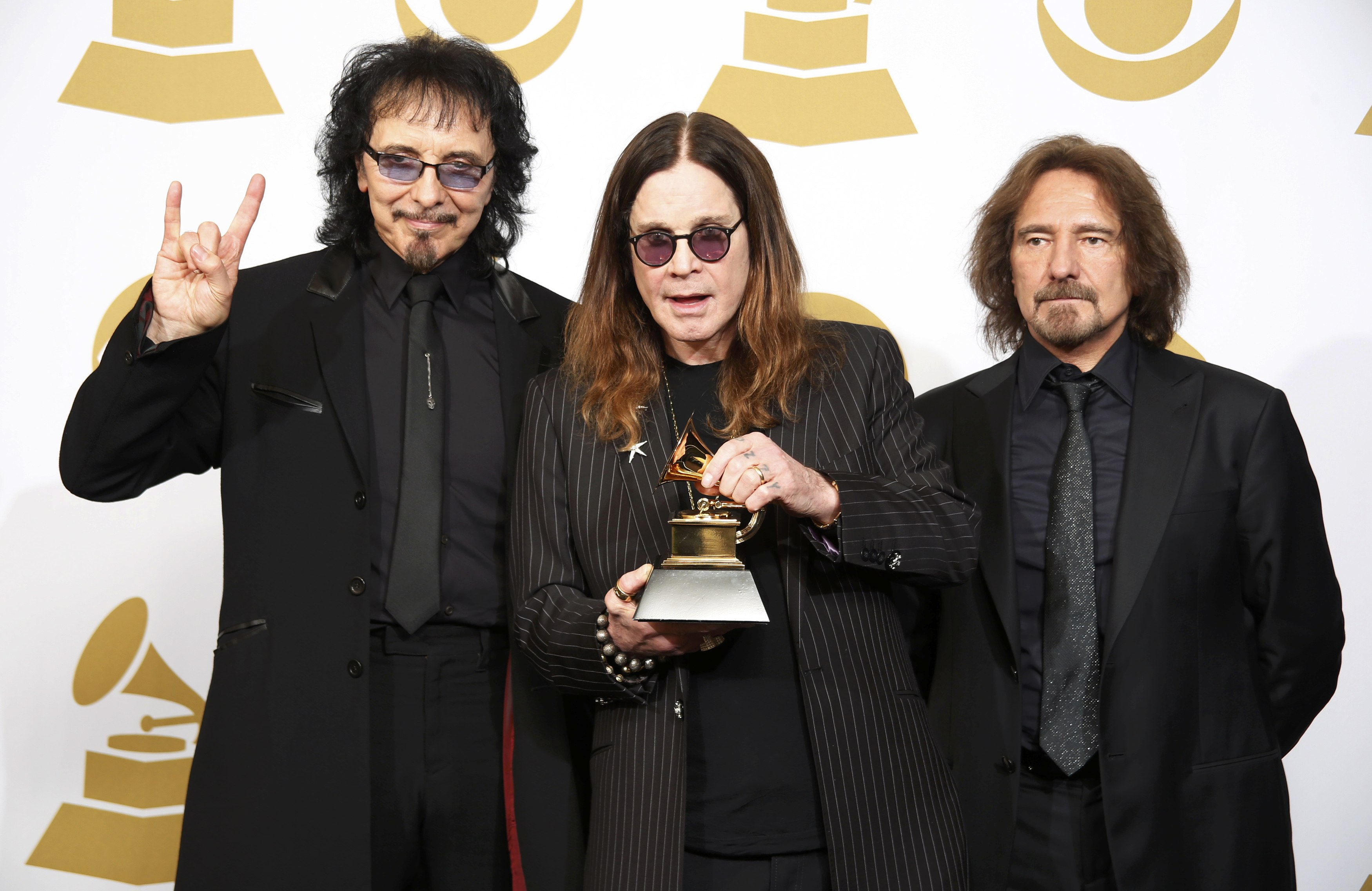 "Musicians Tony Iommi, Ozzy Osbourne and Geezer Butler of Black Sabbath pose with their award for Best Metal Performance for ""God is Dead?"" at the 56th annual Grammy Awards in Los Angeles"