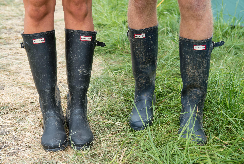 GLASTONBURY, ENGLAND - JUNE 26: Festival goers wear wellington boots in preparation for rain during the Glastonbury Festival at Worthy Farm on June 26, 2014 in Glastonbury, England. (Photo by Ian Gavan/Getty Images)