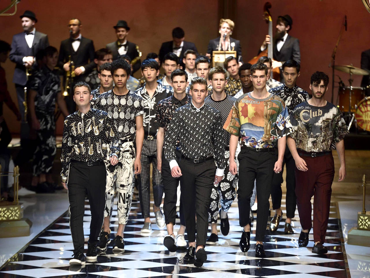 Models wear creations for Dolce&Gabbana men's Spring Summer collection part of the Milan Fashion Week, unveiled in Milan, Italy, Saturday, June 18, 2016 (Flavio Lo Scalzo/Ansa via AP)