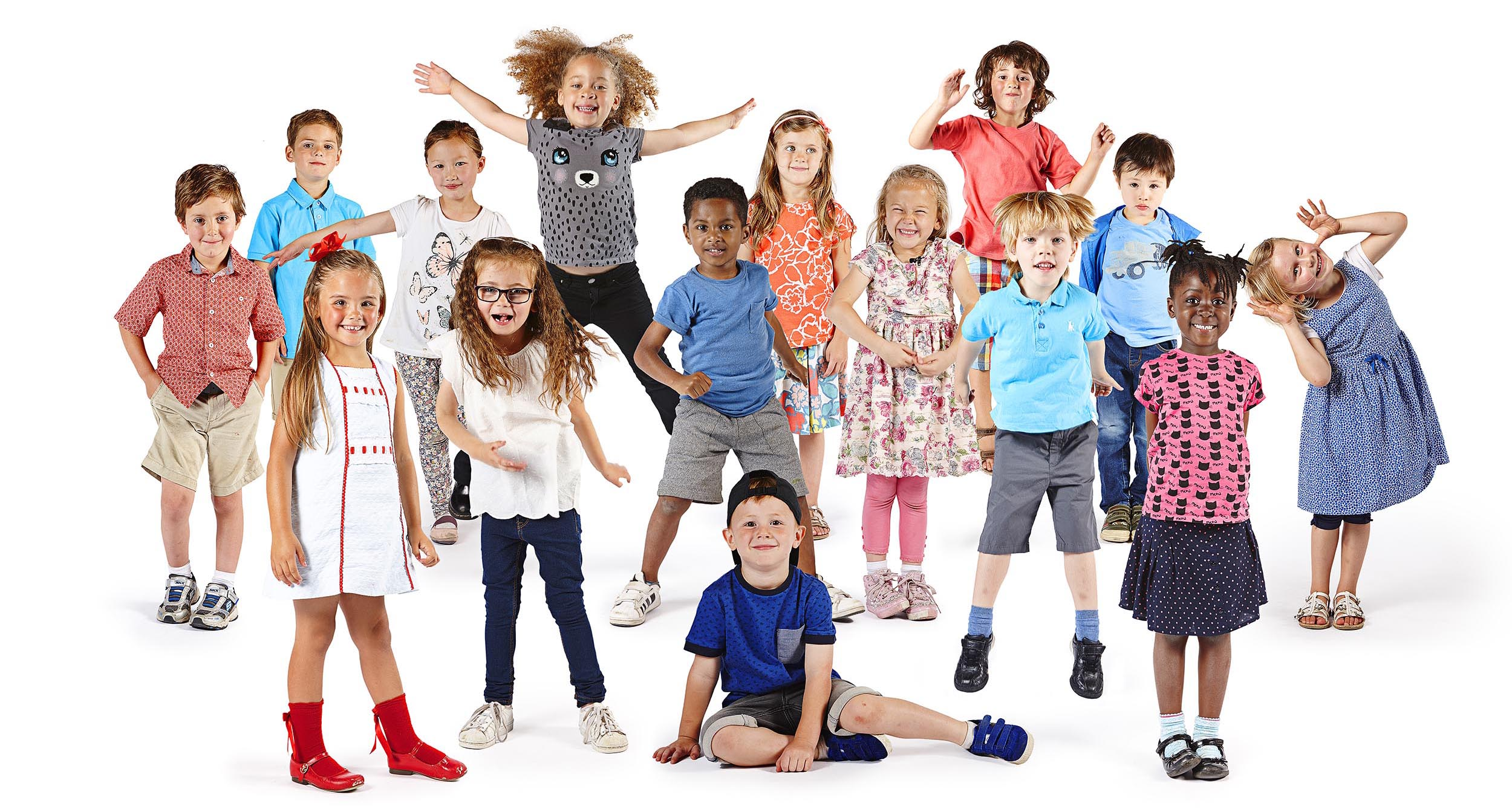 Front row Sienna (red socks and shoes), Emily (glasses), George (sitting down), Alfie (turquoise polo, blond hair), Ruth (pink and black print top). Back row: Arthur (beige shorts and trainers), Charlie, Brooke, Jaja, Devan, Olive (orange print top), Lily (clasping hands), Joshua, Ferdinand (blue t-shirt and jacket) and Emilia (blue dress).