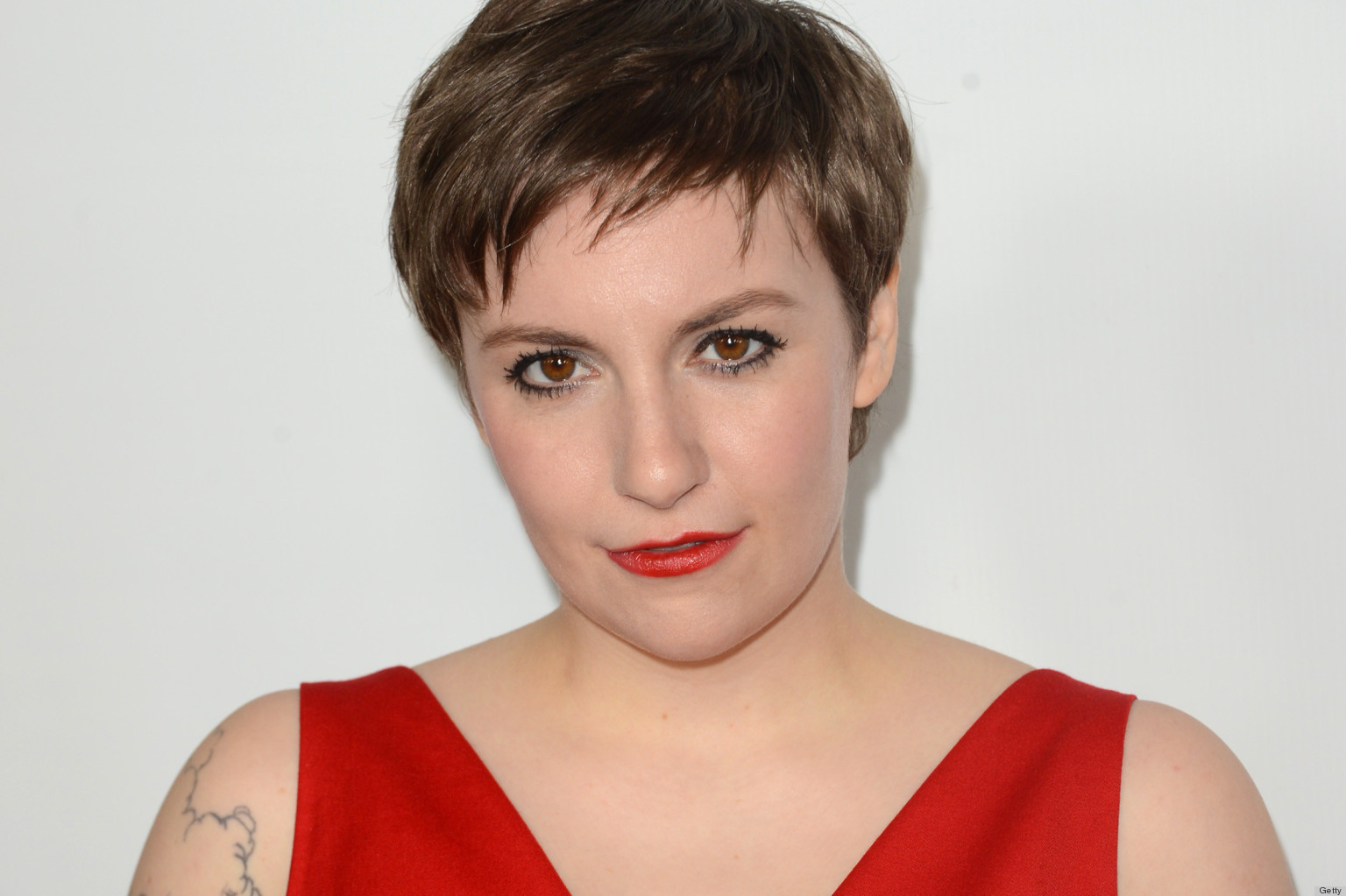 "HOLLYWOOD, CA - DECEMBER 12: Actress Lena Dunham attends the premiere Of Universal Pictures' ""This Is 40"" at Grauman's Chinese Theatre on December 12, 2012 in Hollywood, California. (Photo by Jason Merritt/Getty Images)"