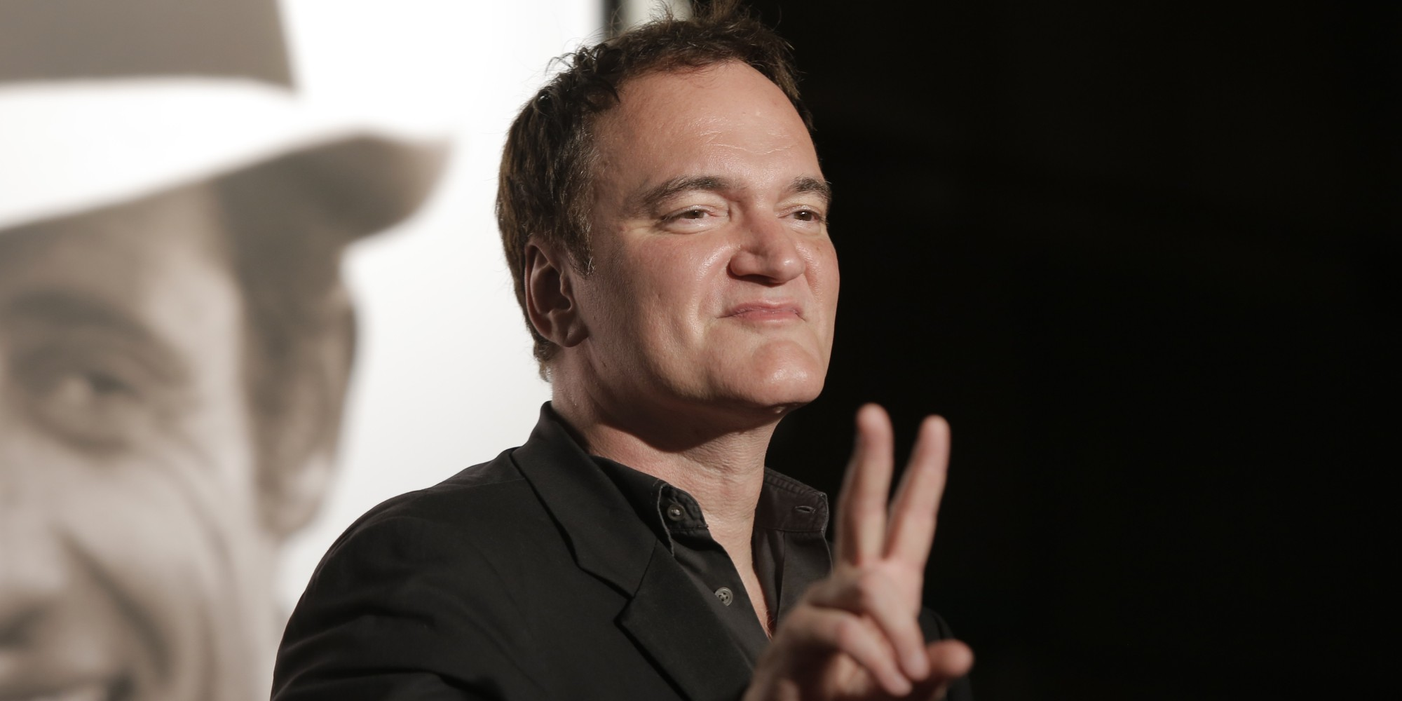 Director Quentin Tarantino gestures as he arrives at the 5th edition of the Lumiere Festival, in Lyon, central France, Monday, Oct. 14, 2013. (AP Photo/Laurent Cipriani)